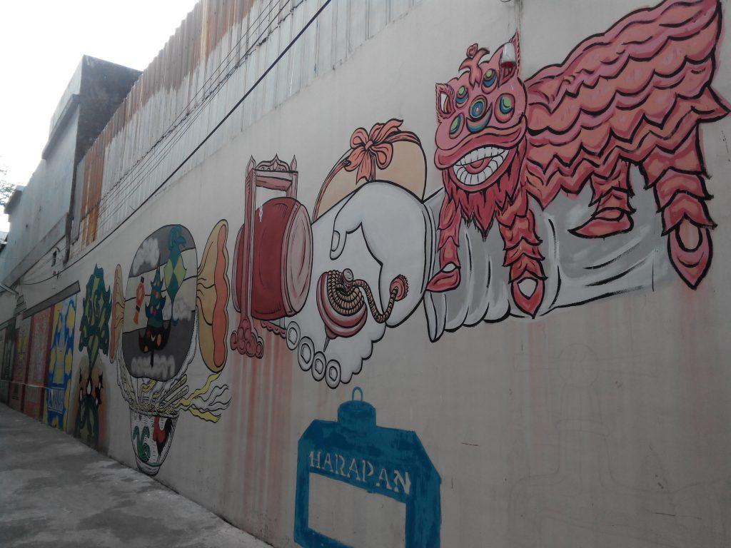 Desain Mural yang Menghiasi gang Ruhana